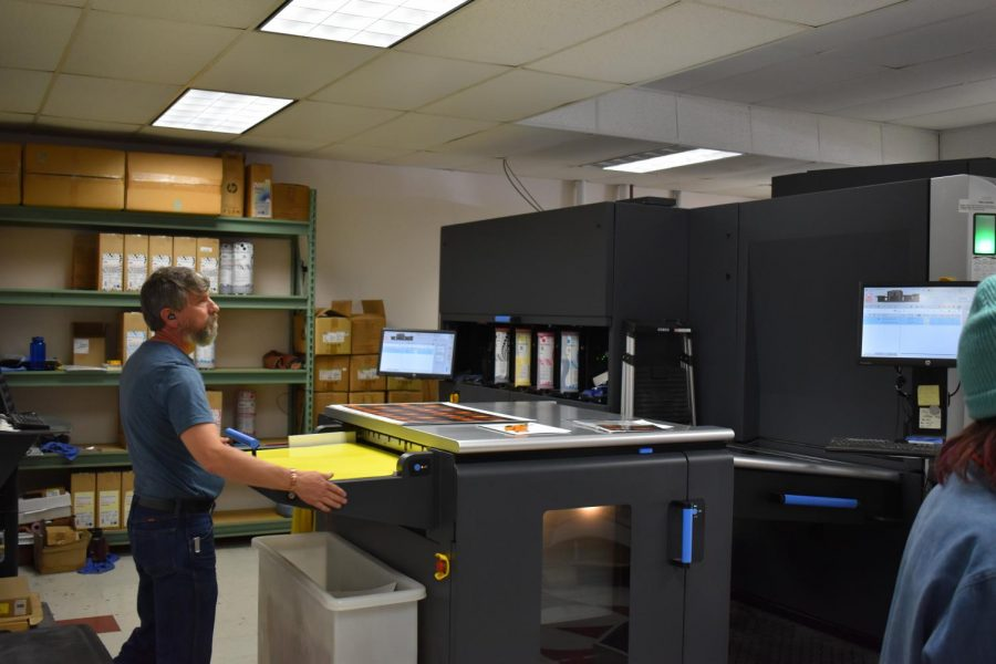 An employee monitors the HP® Indigo 10000 Digital Press, which uses impressive color printers to bring vivid digital imagery to life. April 23, 2021.
