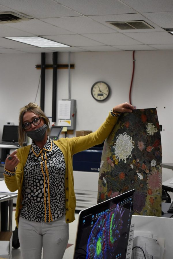 Abby Noble shows off an example of a larger-scale print. In this case, a poster. April 23, 2021.