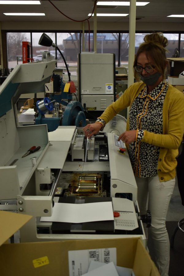 A machine used to bind and cut books to size, Abby Noble explains the process, which begins with the pages being aligned and glued together, bound to the cover. April 23, 2021.