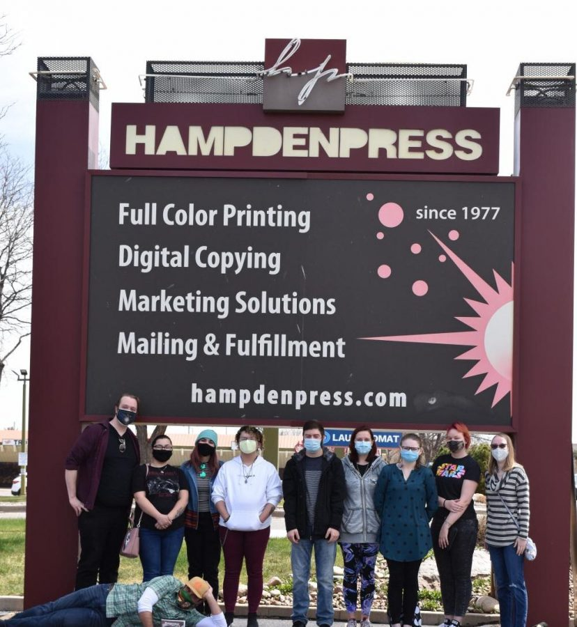 The Progenitor team gathers outside Hampden Press, posing as a group for the first time on April 23, 2021.  Left to right: Connor Sandrock, Kalyca McQuire, Samantha Scanlon, Zachary Vultao, Dalton Giesick, Jocelyn Hodovance, Meagan White, Melissa Morse, Mckenzie Marner.  Front: Professor Jamey Trotter