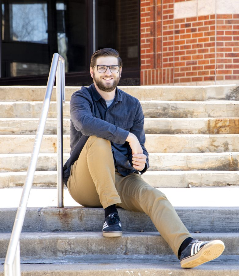 Soon to be graduate, Kevin Cady, sits on the steps of the Art and Design building at Arapahoe Community College. Thursday April 1st, 2021.