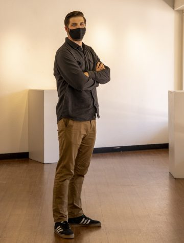 Soon to be graduate, Kevin Cady, poses in the art and design gallery at Arapahoe Community College. Thursday April 1st, 2021.