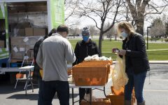 Volunteers organize Starbucks donations in the ACC parking lot. April 14th, 2021