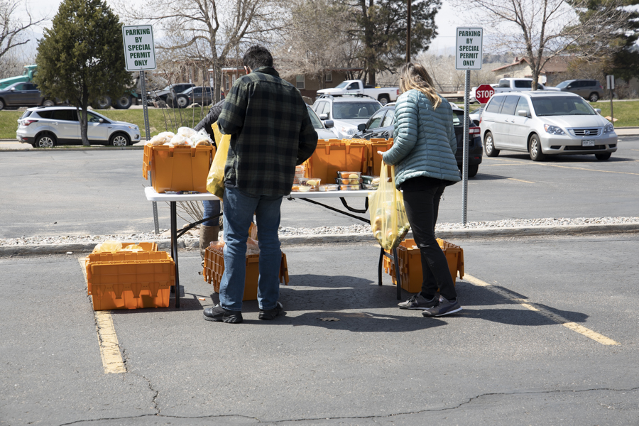 Volunteers pack food bags of food for pick up in the ACC parking lot. April 14th, 2021