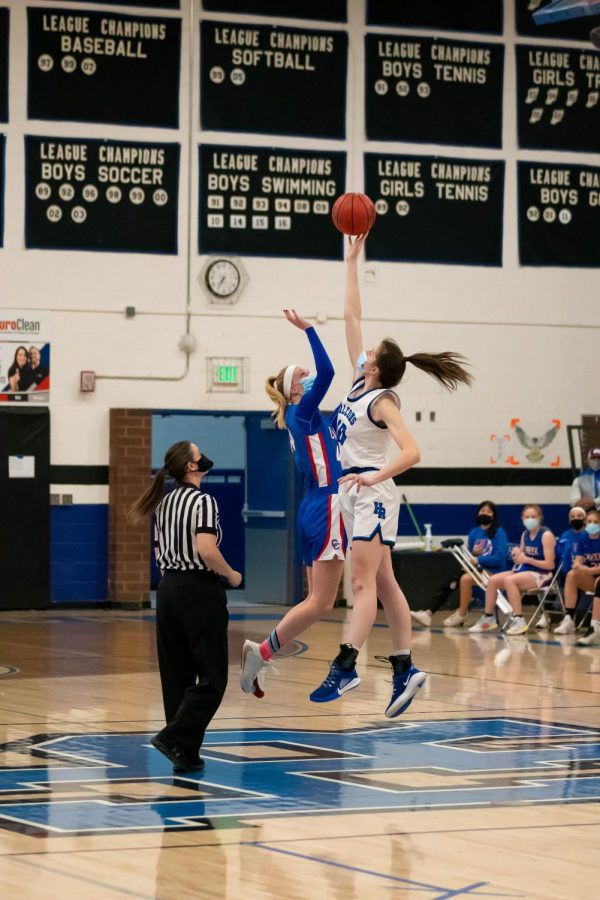 Creek and Highlands Ranch players jump for the center toss at Highlands Ranch High School on March 9th, 2021.