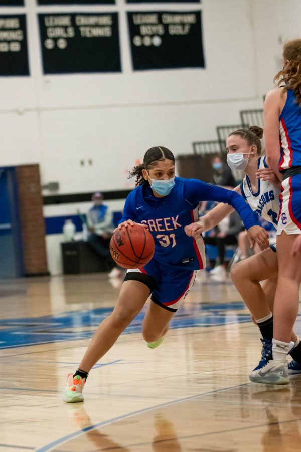Mireya Johnson fights to find an opening for a clear shot of a basket at Highlands Ranch High School on March 9th, 2021.