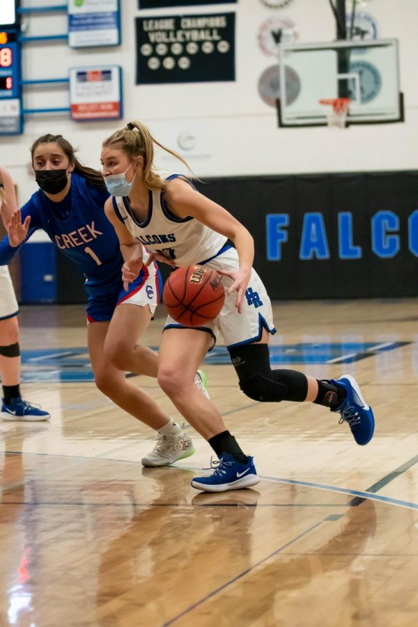 Highlands Ranch player makes a break for the basket at Highlands Ranch High School on March 9th, 2021.