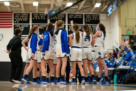 Highlands Ranch Falcons come together as a team during halftime to figure out their game strategy for the second half at Highlands Ranch High School on March 9th, 2021.