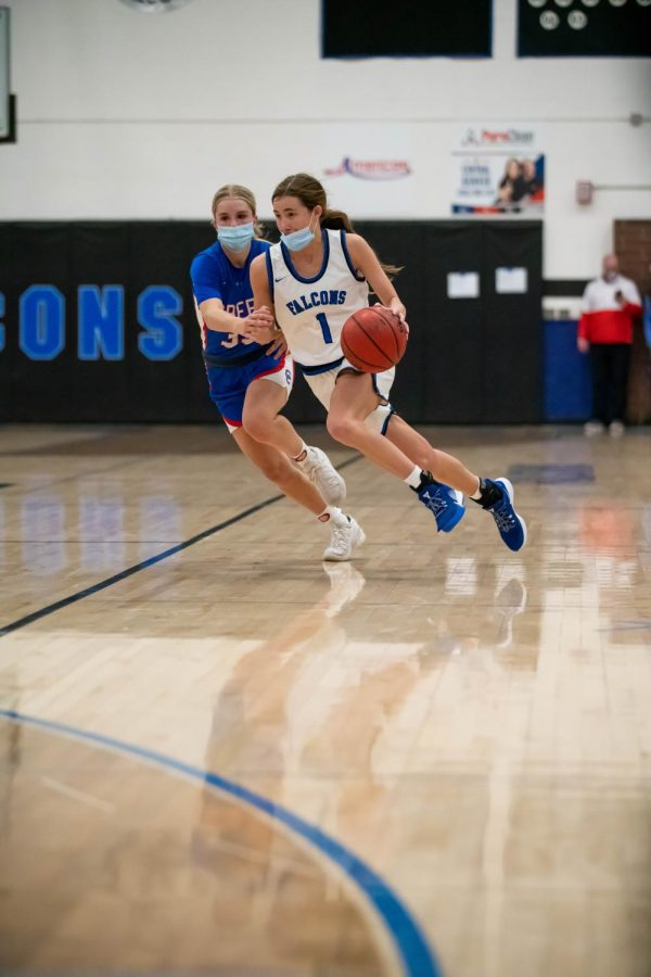 Payton Muma charges for an opening to the basket at Highlands Ranch High School on March 9th, 2021.